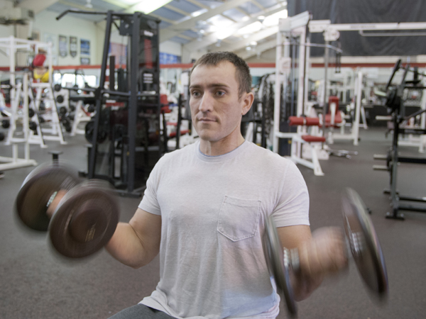 Sean Alexander lifts weights at The Courthouse Racquet and Fitness exercise center in Flowood.