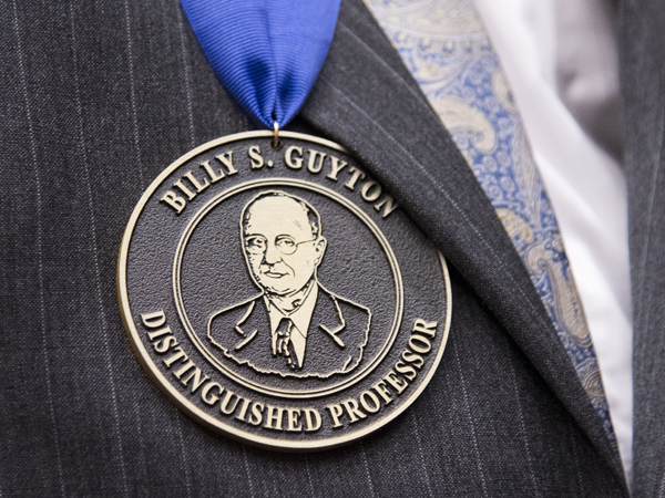 The Billy S. Guyton Distinguished Professor honor is given every five years to faculty who demonstrate a commitment to research and education.
