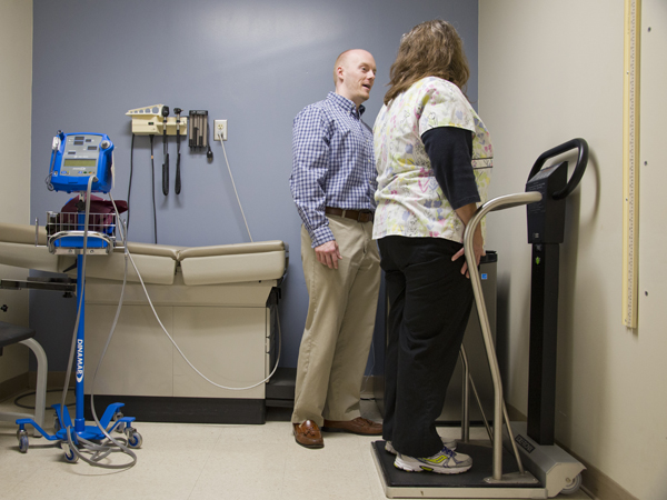 UMMC registered dietitian Paul Robertson takes the weight and height measurements of patient Edna Taylor of Bentonia.
