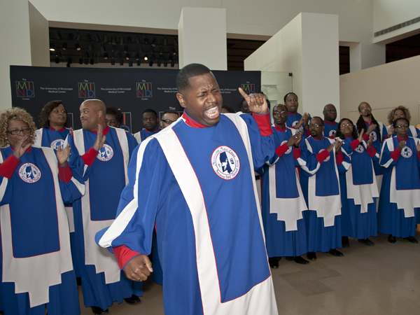 Jermichael Riley leads the Mississippi Mass Choir at a party for sponsors of the Gladys Knight benefit concert for the MIND Center. The choir sang several songs at the pre-concert event hosted at the Mississippi Museum of Art shortly before the concert on Sunday night.