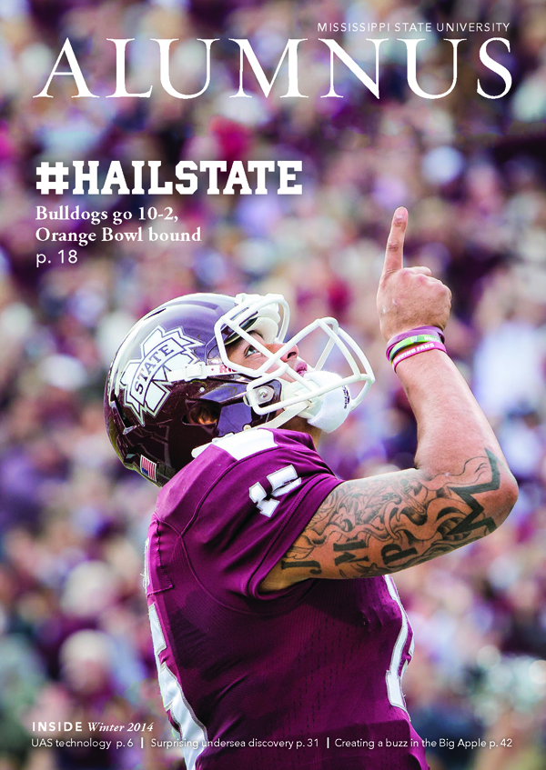 The winter 2014 cover of Alumnus magazine features Dr. Mark Reed's photo of Mississippi State University quarterback Dak Prescott.
