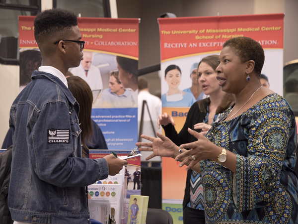 Murrah student Jarvis Banks talks with Dr. Marilyn Harrington about a career in nursing.