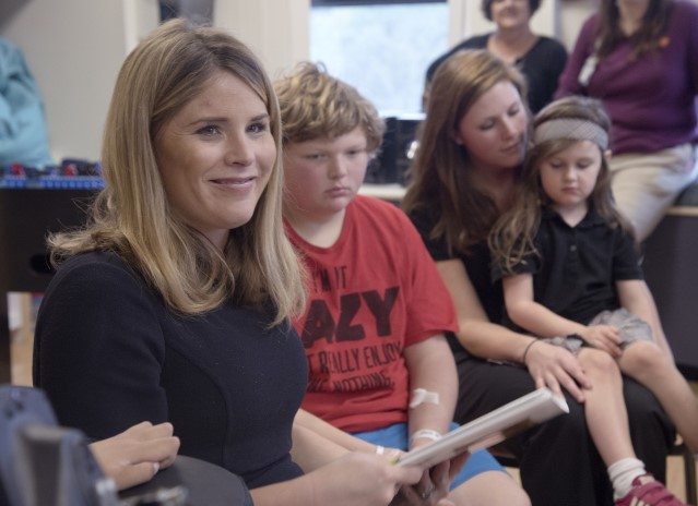 "Jenna Bush Hager reads from the book, ""Read All About It!,"" that she authored with her mother, former first lady Laura Bush. At her side is Nicholas Page of Little Rock, Arkansas."