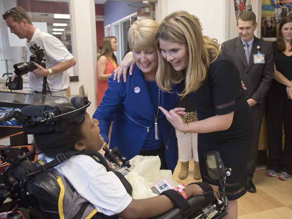 Deborah Bryant, wife of Mississippi Gov. Phil Bryant, and NBC special correspondent Jenna Bush Hager, right, daughter of 43rd President George W. Bush, chat with Batson Children's Hospital patient DeAsia Scott.