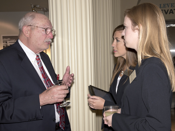 Dr. James Williford of Hattiesburg holds forth with STARS and M2s Meagan Henry, center, and Natalie Ethridge during the Medical Alumni & Friends Awards Dinner, August 15, at River Hills Country Club in Jackson.