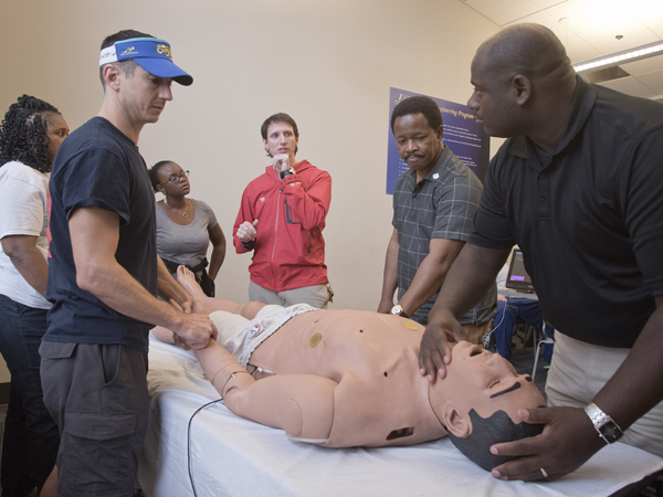 l-r Jason Wheat, (M3) Bertiel Harris, Yolanda Griffin, Nick Hoda (UMMC ER) Lindsey Horton and Elvis McGee during CPR training.