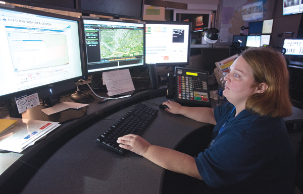 Samantha Tucker, communications specialist and dispatcher in the MED-COM emergency response center, keeps an eye on severe storms moving across Mississippi.
