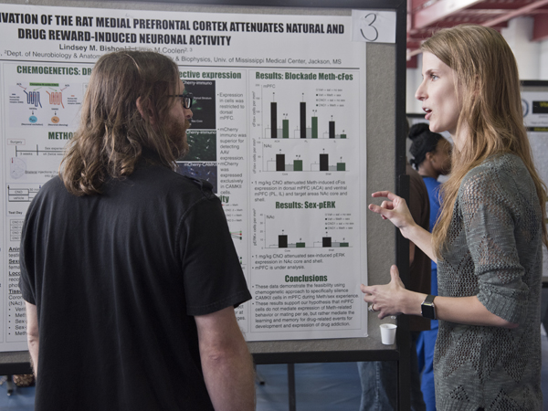 Bishop explains her research to Dr. Ryan Darling, associate professor of neurobiology and anatomical science.