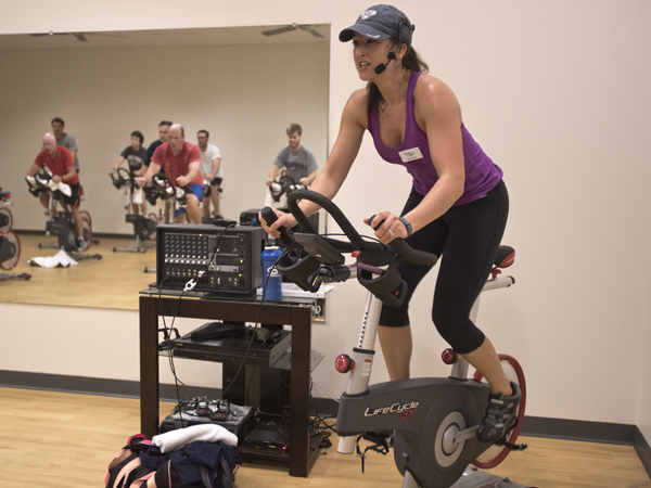 Emily Tullos, a group fitness instructor at the University Wellness Center downtown Jackson branch, leads a spin class.