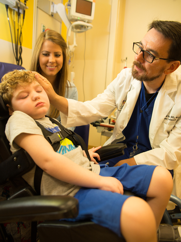 Boyte examines patient Cooper Newell as his mother Noel looks on. Photo credit: The Schwartz Center for Compassionate Healthcare
