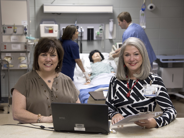 Dr. Robin Christian, left, and Dr. Janet Harris in the School of Nursing's simulation lab