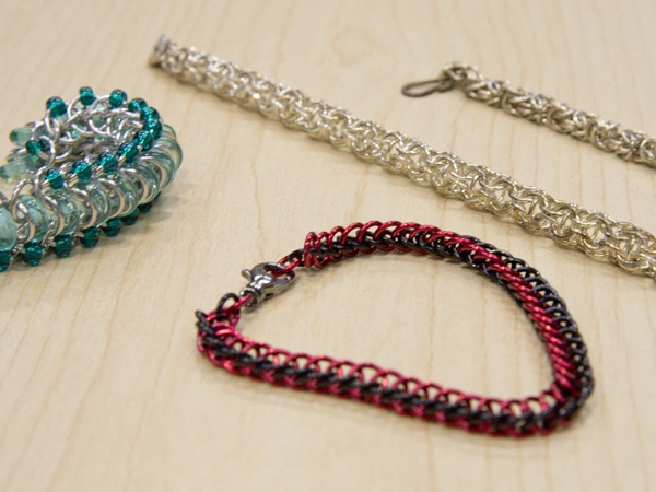 Tiny metal links are intertwined to create chainmaille jewelry.