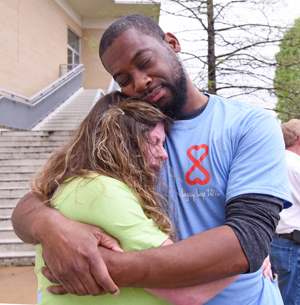 Christine Jordan of Tupelo hugs Sam Walker of Pearl moments after they met for the first time at the Legacy Lap. Walker received the pancreas and kidney of Jordan's son Gabriel.