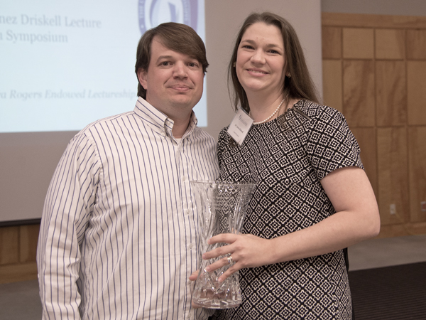 Josie and husband Lee Bidwell, assistant professor of biochemistry, celebrating her Alumnus of the Year honor.