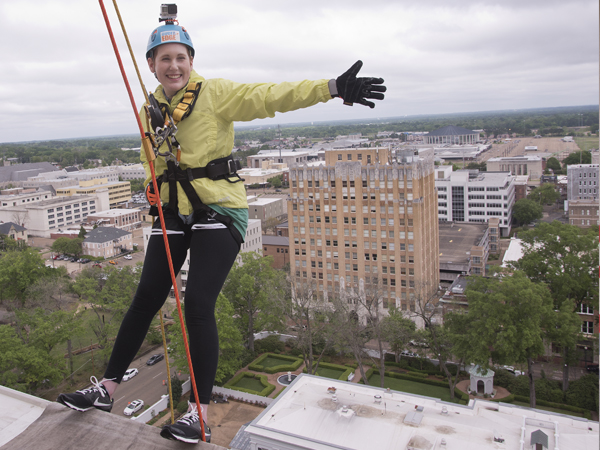 Maggie Hanberry stops to take in the view before rappelling 14 stories Saturday. She was heading up Team Maggie, which included her parents, a cousin and a family friend. The Hattiesburg group raised more than $7,200 for Friends of Children's Hospital in the fundraiser.