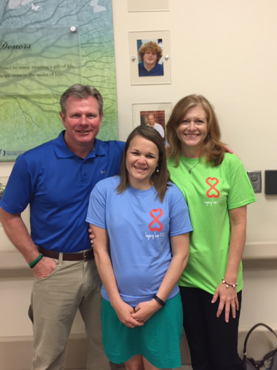 Jackson residents David and Sheila Wilbanks met Foley, Ala., resident Sarah Thornbury (center), who received their son Walker's kidney and pancreas, during the 2015 Legacy Lap.