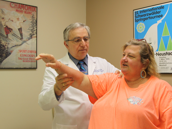 Speca tests the range of motion on patient Jennifer James, who suffered a dislocated shoulder.