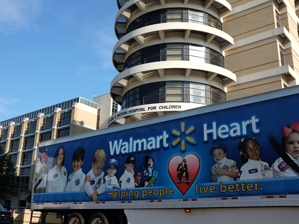 The Walmart truck Morgan rode to Clinton in tells the story of the company's commitment to pediatric care.