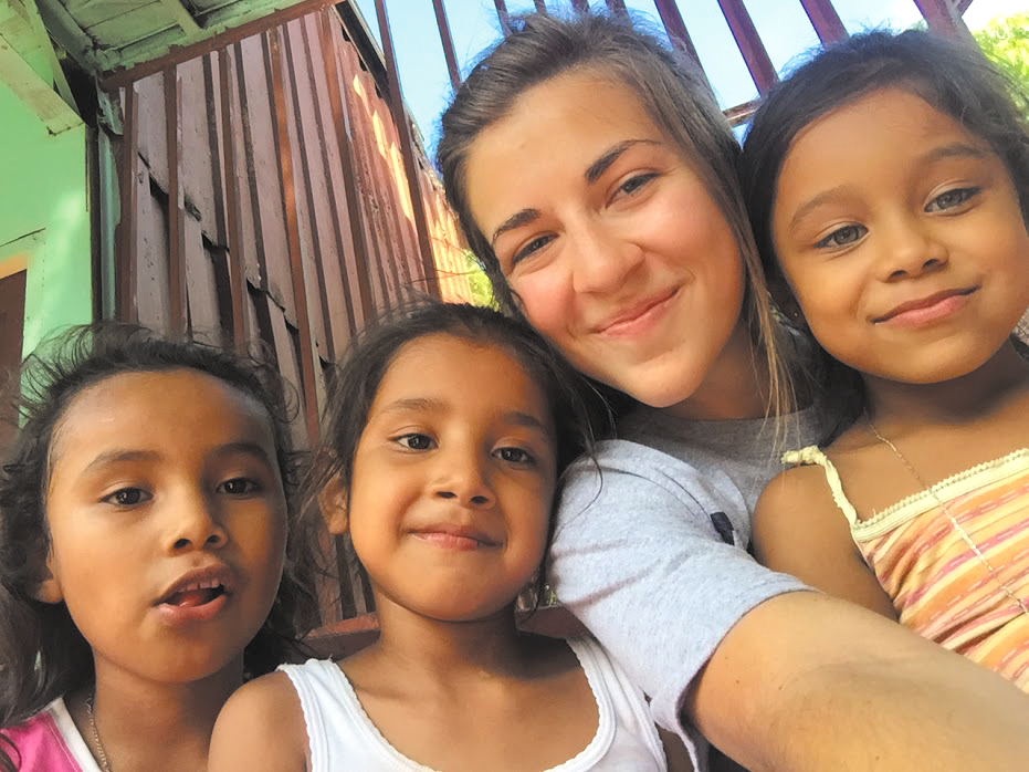 Meagan Henry bonds with the children of some patients in Nicaragua.