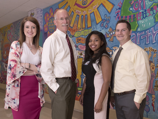 The UMMC SPARK team from left, research coordinator Kristen Callahan, Annett, research coordinator Sabrina White and assistant professor of pediatrics Dr. Dustin Sarver.