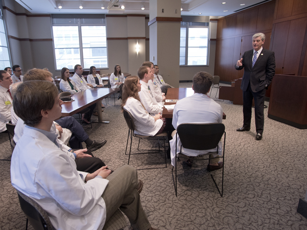 Gov. Phil Bryant talks with UMMC medical students during Capitol Day Tuesday, encouraging them to practice in Mississippi and reach out to patients through the use of telehealth technology. Bryant and his wife, Deborah Bryant, are frequent visitors to Batson Children's Hospital, and he shared his vision for an expanding medical zone in Jackson.