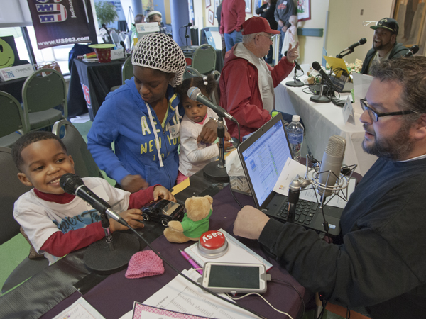 DeNarahri Middleton, left, makes his radio debut during the 2015 Radiothon with Vicksburg station K-Hits while mom Decimbra and sister Deniylah listen in.