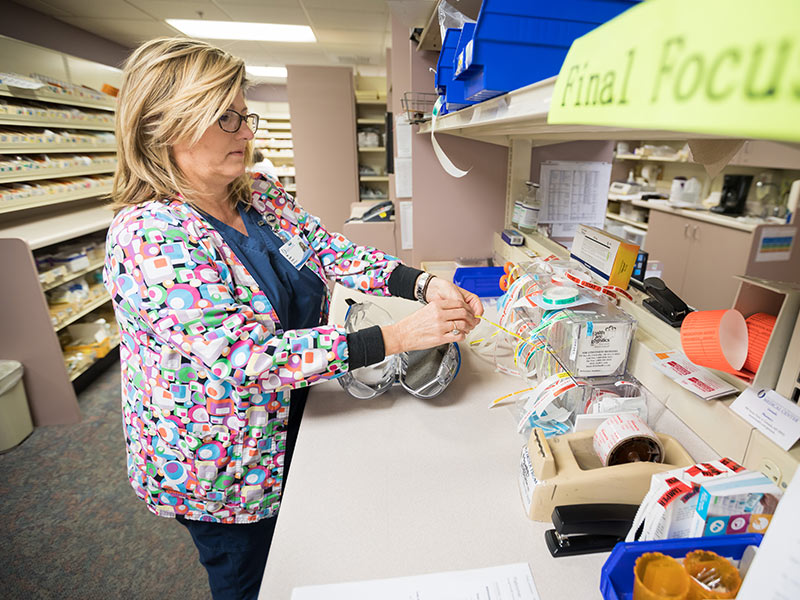 "Pharmacist Kim Upton prepares patient medications in the UMMC Grenada pharmacy. Ensuring patients receive the right medication in the correct dose is just one part of the Medical Center's ""Chasing Zero"" error prevention campaign."