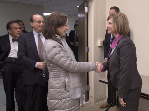 Woodward greets Gloria Bellelli, consul general for Italy in Miami.