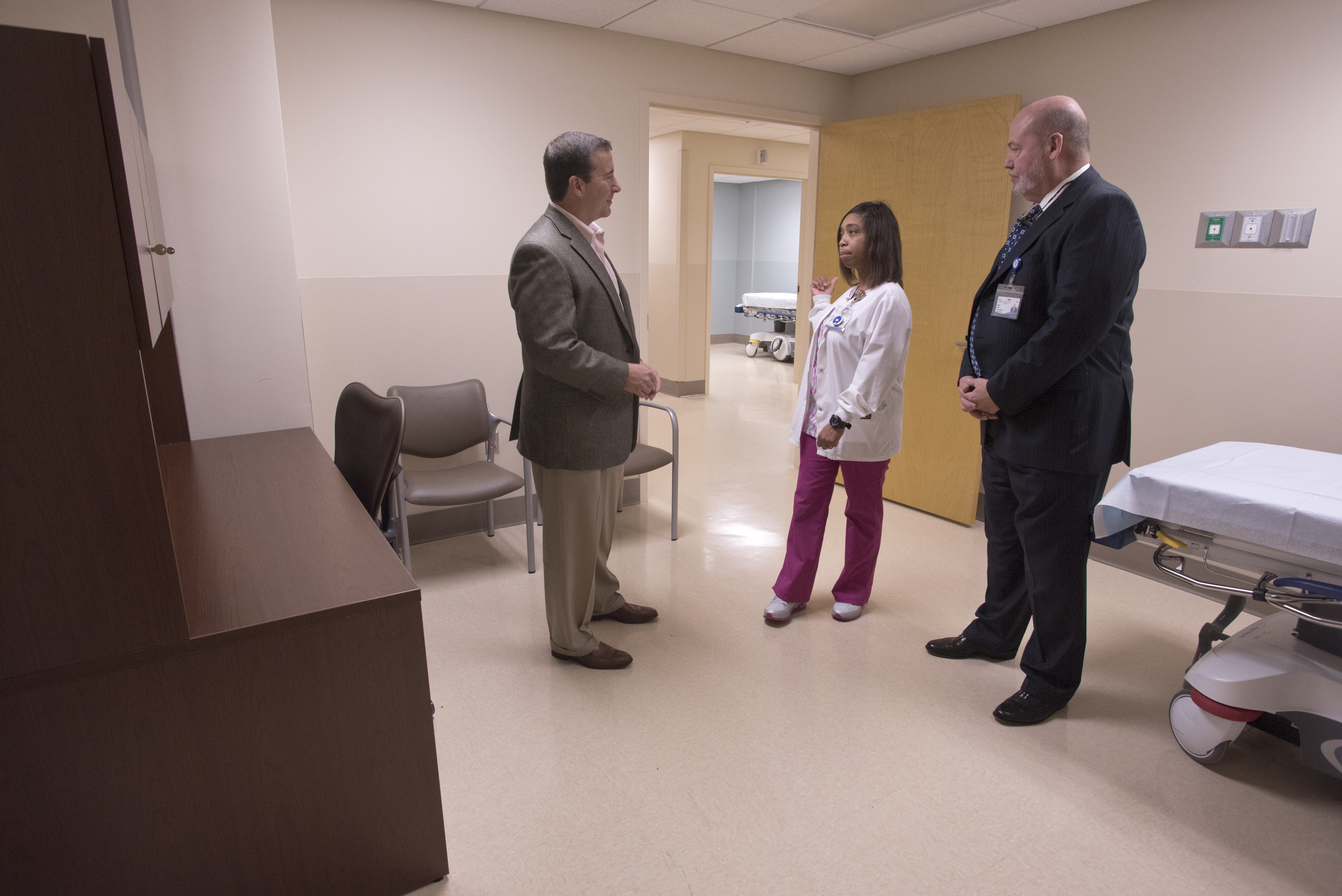 Kevin Cook (left), CEO of University Hospitals and Health System, and David Putt, CEO of UMMC Holmes County and UMMC Grenada, get a tour of the Lexington hospital's new Emergency Department triage room from registered nurse Lakessha Head.