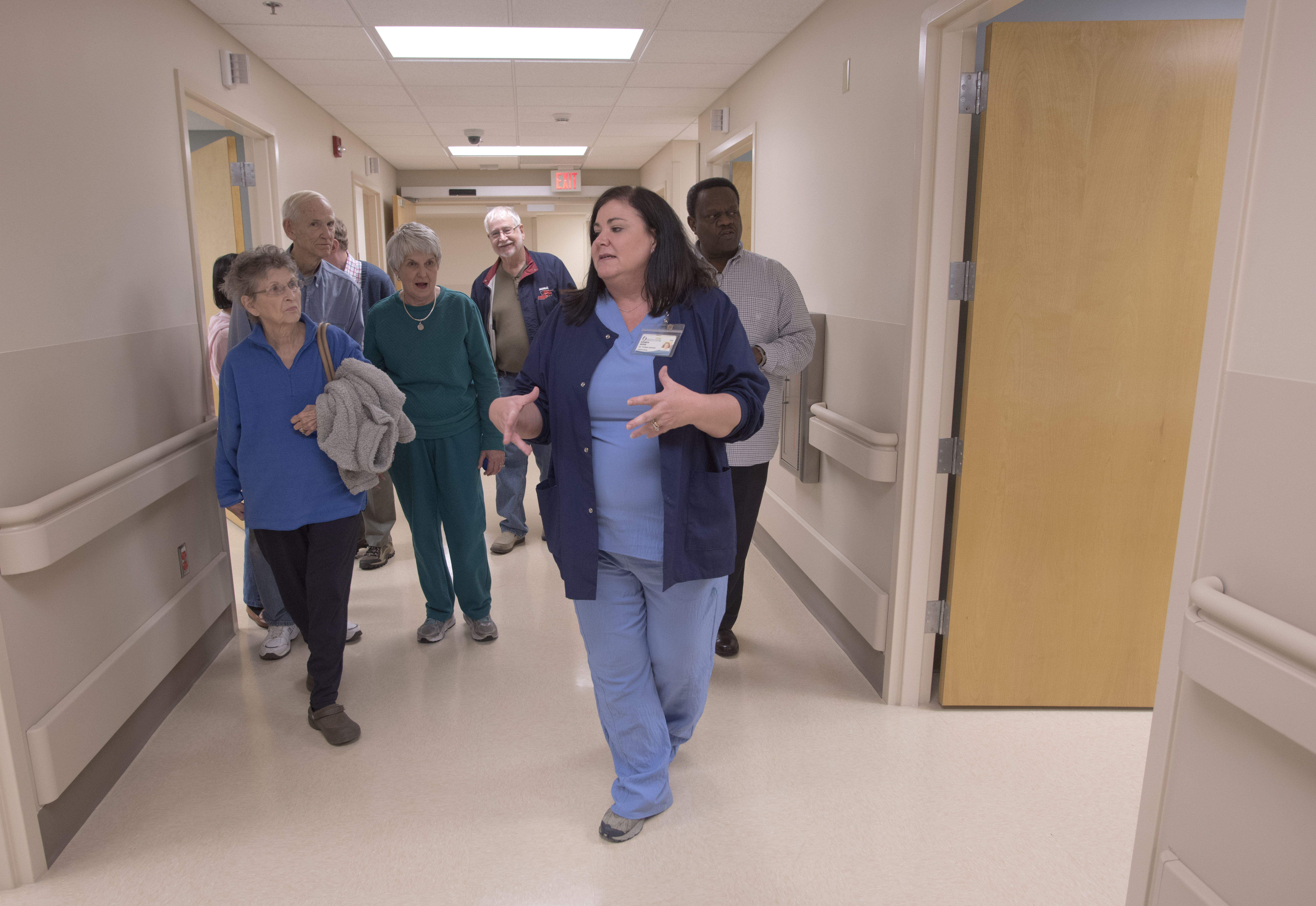 Elizabeth Adcock, manager of performance improvement at UMMC Holmes County, shows off the Lexington hospital's new Emergency Department to a crowd of local residents during a Jan. 15 open house.