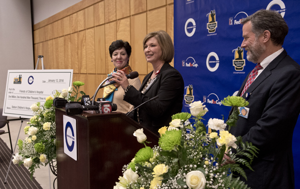 Dr. LouAnn Woodward, UMMC vice chancellor for health affairs and dean of the School of Medicine, thanks Century Club Charities and Sanderson Farms for a $1.109 million gift to Friends of Children's Hospital. Looking on are Dr. Renate Savich, professor of pediatrics and chief of the Division of Newborn Medicine, and Dr. Rick Barr, Suzan B. Thames Professor and Chair of Pediatrics.