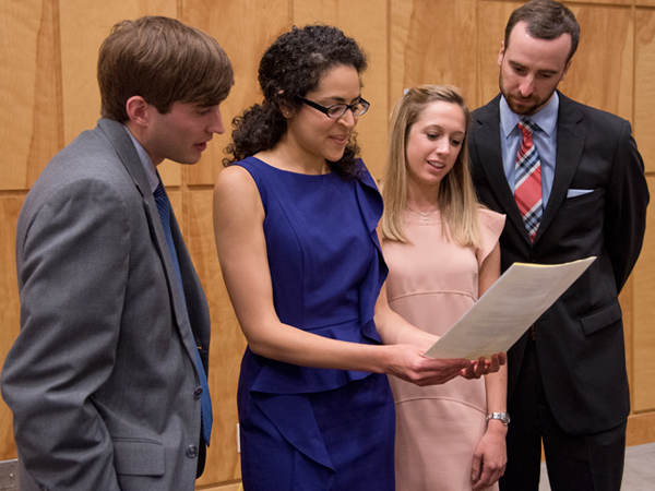 Christine Hayden is sworn in as secretary during the 2015 ASB Officer Installation Banquet May 4, 2015. From the left are Chris Price, D3, treasurer; Sara Ali, M3, president; Hayden; and Jeff Peeples, M3, vice-president.