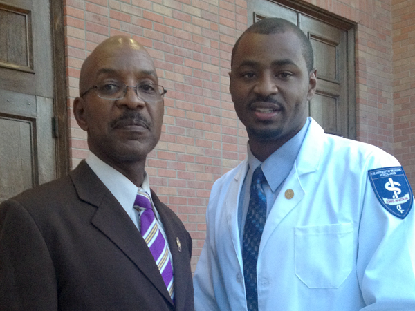 Nate in a picture with his father after receiving his white coat in 2015.