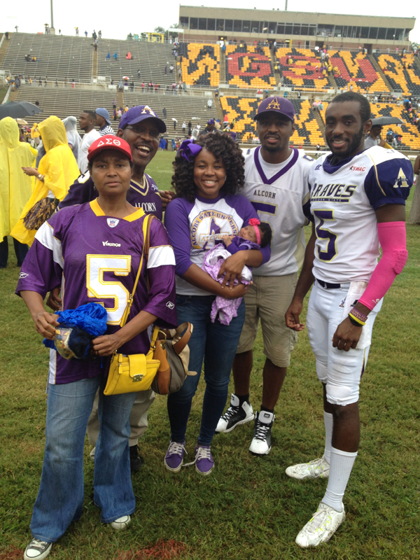 Nate Hughes, second from right, and other members of his family visit Nate's brother Charles Hughes, far right, at an Alcorn State University football game. The others are, from left: mom Gwendolyn Hughes, dad Nathaniel N. Hughes, and sister Morgandy Hughes, holding Nate Hughes' daughter Zhoë, who turns 2 this year.