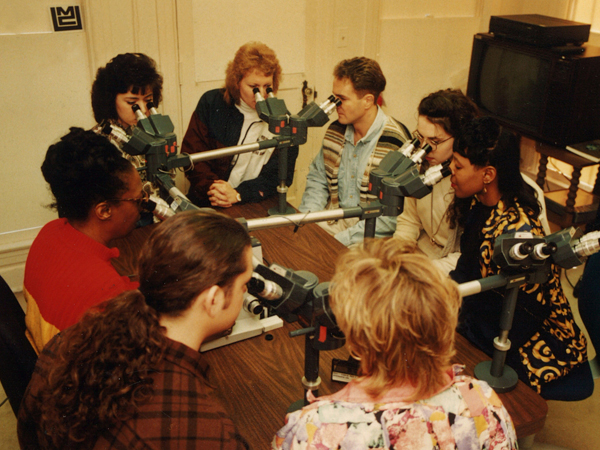 Cason, left in red, views slides with a class of cytotechnology students in the '80s.