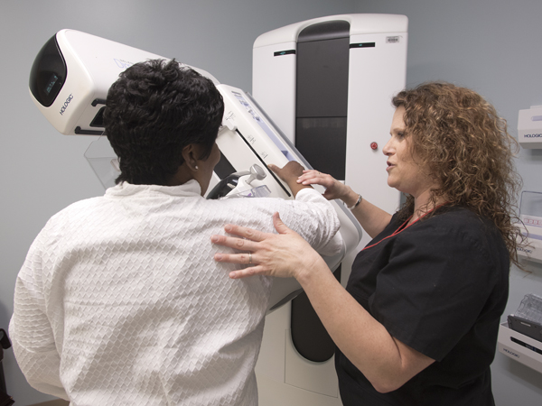Tammy Williams, a mammography technologist at the Breast Imaging Center, walks Smith of Clinton through the new 3D mammography procedure.