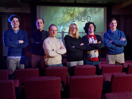 Dooley, third from right, with fellow LIGO team members.