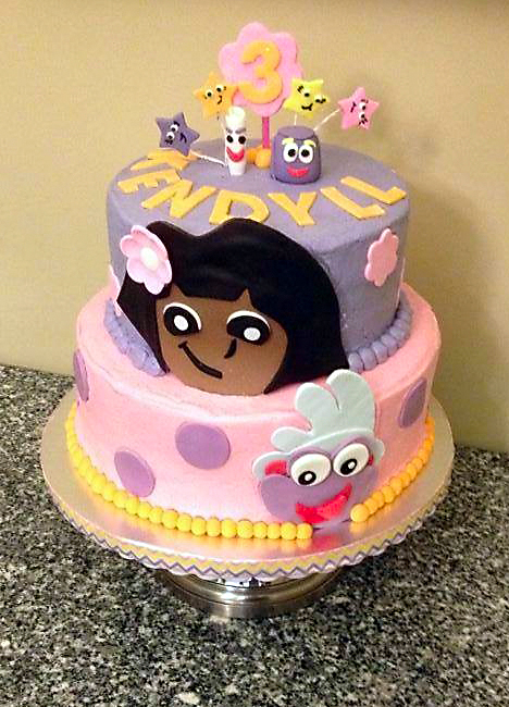 Bidwell and Lee created a Dora-themed cake for the nonprofit Icing Smiles, Inc.