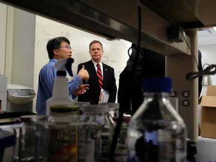 Dr. Erik Hom (left), assistant professor of biology at UM, explains his research on microbial communities to Vitter during a visit to Hom's lab as part of Vitter's Flagship Forum tour.