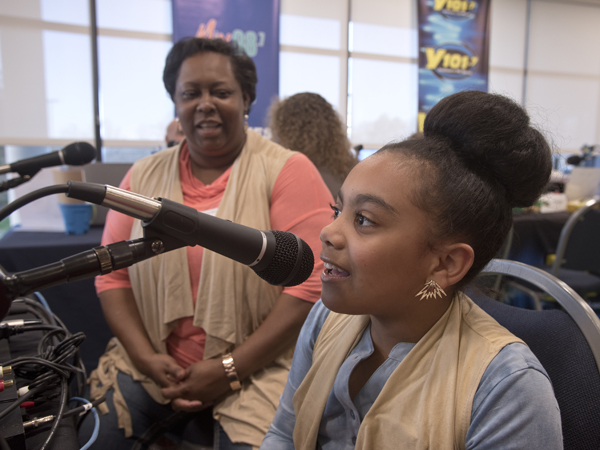 "Zeporah Levy listens to daughter Destiny Triplett sing a favorite song from ""Frozen"" during her time as a spokesperson in the Mississippi Miracles Radiothon."