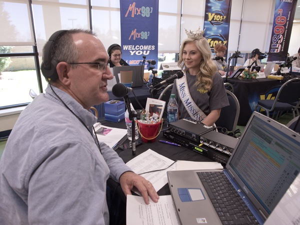 Mark McCoy, an on-air personality for 100.9 The Legend, interviews Miss Mississippi Hannah Roberts during the Mississippi Miracles Radiothon.