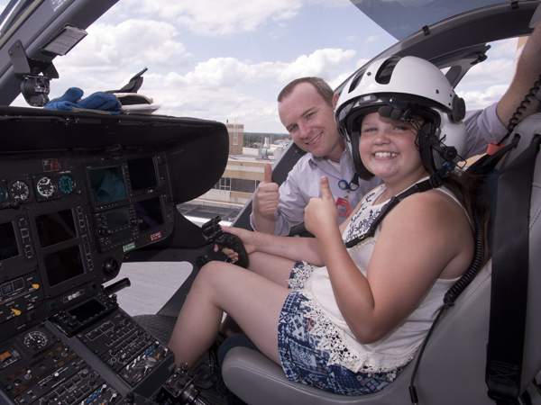 Marshall and Abby inside the cockpit of one of AirCare's three helicopters.