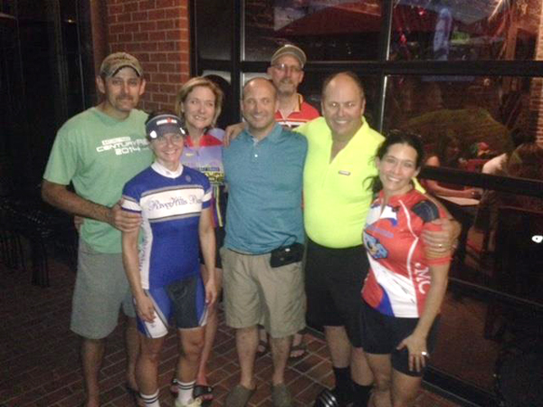Fellow bicyclists who helped save the life of David Lindsey, center, include, from left, Randy Tackett, Denise Mills, Jill Warner, Rik Tice, T. Logan Russell and Alyssa Silberman.