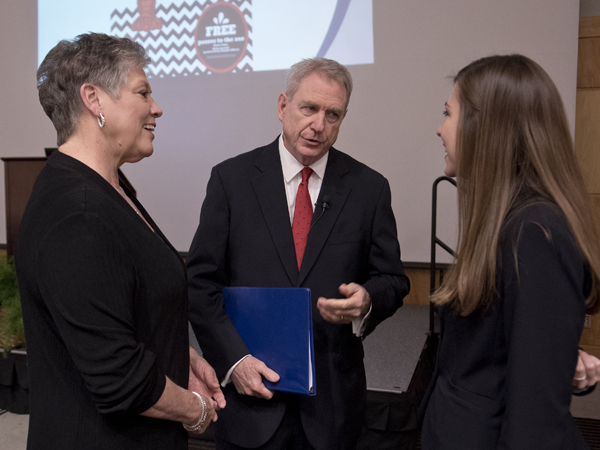 Jones, center, speaks with wife Lydia, left and M2 student Meagan Henry before the Last Lecture.