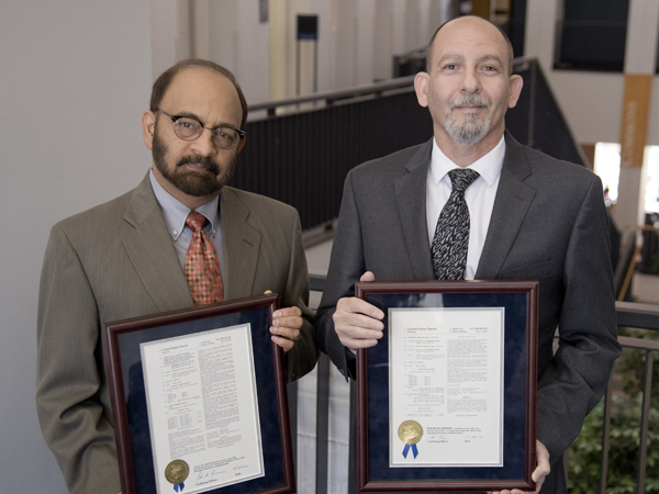 Patent recipients Dr. Parminder Vig and Dr. Wael ElShamy.