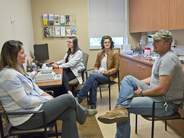 Lindsey and Brad chat with Gonzalez, and Renee Stoehr, the department's project manager.