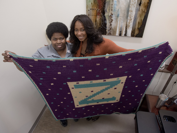 Robinson crocheted a personalized throw for Zonzie McLaurin