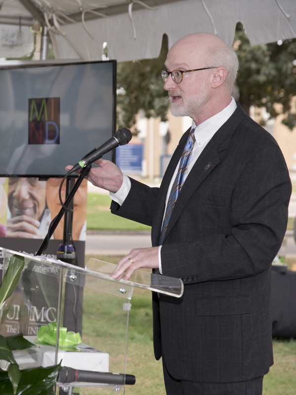 Dr. Tom Mosley, director of the MIND Center, speaks at the announcement ceremony.