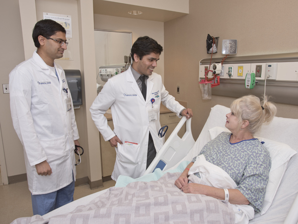 Patient Gerry Huckaby of Clinton chats with her hospitalist, Dr. Raman Palabindala, center, and Dr. Chirag Acharya, an internal medicine resident.