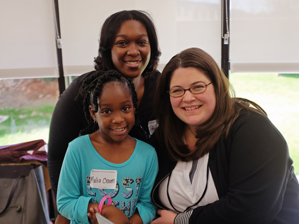 Tiffine Croom and daughter Malia Croom, a former Batson Children's Hospital patient, smile with Shannon Steele of Mix 98.7 March 2 during the March 2016 Mississippi Miracles Radiothon.